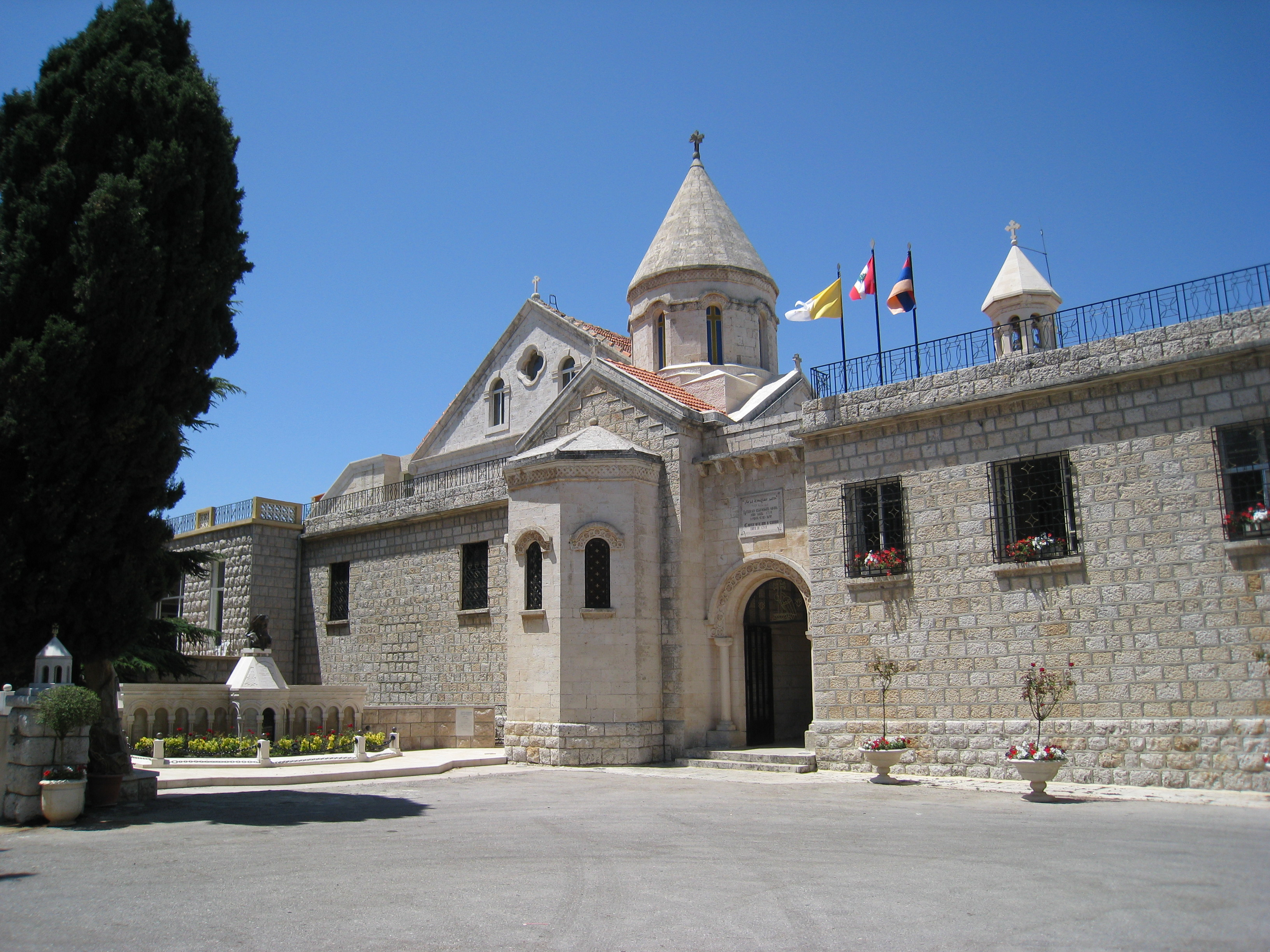 The building of the Armenian Catholic Patriarchate in Bzommar, Lebanon, flying the flags of the Vatican, Lebanon, and Armenia